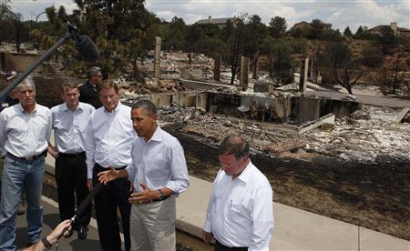 U.S. President Barack Obama speaks to the media during his visit to fire damaged homes in the Mountain Shadow neighborhood in Colorado Springs, June 29, 2012. REUTERS/Larry Downing