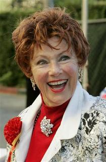 Actress Marion Ross, best known for her role in the television series ''Happy Days'', poses as she arrives for the 73rd annual Hollywood Christmas Parade in Hollywood, California in this November 28, 2004 file photo. REUTERS/Fred Prouser/Files