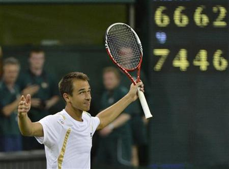 Lukas Rosol of the Czech Republic celebrates after defeating Rafael Nadal of Spain in their men's singles tennis match at the Wimbledon tennis championships in London June 28, 2012. REUTERS/Toby Melville