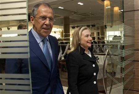 U.S. Secretary of State Hillary Rodham Clinton (R) and Russian Foreign Minister Sergey Lavrov leave a meeting in St. Petersburg June 29, 2012. REUTERS/Haraz N. Ghanbari/Pool