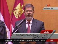 Egypt's first Islamist president Mohamed Mursi attends his swearing in ceremony in this still image from a video footage in Cairo June 30, 2012. Mursi took his oath of office on Saturday, ending six decades of rule by former military men although the generals in charge since Hosni Mubarak was ousted last year have already curbed his powers. REUTERS/Egyptian Television via Reuters TV
