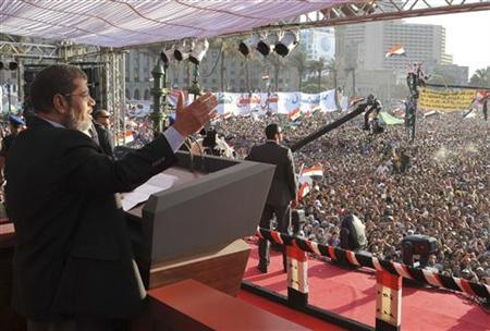 Egypt's Islamist President-elect Mohamed Mursi delivers a speech in Cairo's Tahrir Square June 29, 2012. REUTERS/Egyptian Presidency/Handout