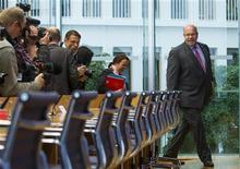 Germany's new Environment Minister Peter Altmaier arrives at a news conference to outline his policy plans for his term in office in Berlin, May 31, 2012. REUTERS/Thomas Peter (GERMANY - Tags: POLITICS)