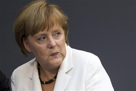 German Chancellor Angela Merkel looks on before delivering a government policy statement in the German lower house of parliament, the Bundestag, in Berlin, June 29, 2012. REUTERS/Thomas Peter