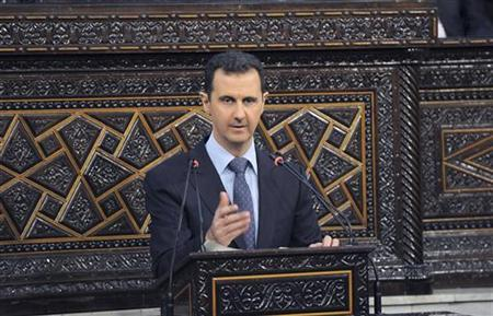Syria's President Bashar al-Assad delivers a speech to Syria's parliament in Damascus, June 3, 2012, in this handout photograph released by Syria's national news agency SANA. REUTERS/SANA/Handout