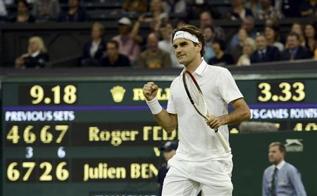 Roger Federer of Switzerland celebrates after defeating Julien Benneteau of France in their men's singles tennis match at the Wimbledon tennis championships in London June 29, 2012. REUTERS/Dylan Martinez