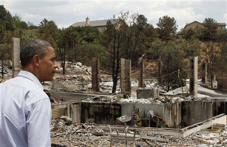 U.S. President Barack Obama surveys fire damaged homes in the Mountain Shadow neighborhood in Colorado Springs, June 29, 2012. Obama on Friday promised federal assistance for Colorado's worst-ever wildfire as he toured damage caused by the blaze, which has killed at least two people, destroyed hundreds of homes and forced the evacuation of 35,000 residents in and around the state's second-largest city. REUTERS/Larry Downing