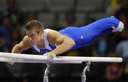 Sam Mikulak competes on the parallel bars at the U.S. Olympic gymnastics trials in San Jose, California June 28, 2012. REUTERS/Brian Snyder