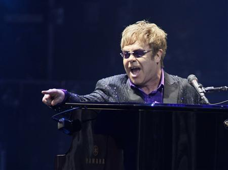 Singer Elton John performs at a charity concert dedicated to the fight against HIV/AIDS at Independence Square in Kiev June 30, 2012. REUTERS/Gleb Garanich