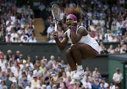 Serena Williams of the U.S. celebrates after defeating Zheng Jie of China in their women's singles tennis match at the Wimbledon tennis championships in London June 30, 2012. REUTERS/Stefan Wermuth