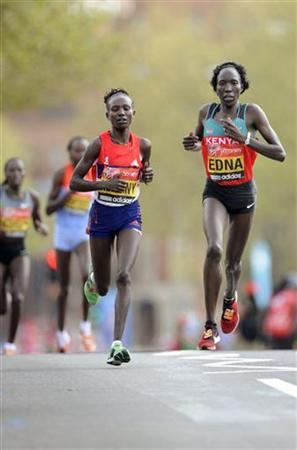 Mary Keitany of Kenya (L) and Edna Kiplagat of Kenya lead the women's section of the London marathon April 22, 2012. REUTERS/Paul Hackett/Files