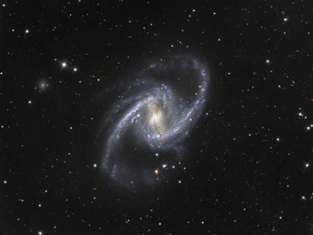 The NGC 1365 galaxy, also known as the Great Barred Spiral Galaxy, is seen in an image that combines observations performed through three different filters with the 1.5-metre Danish telescope at the European Southern Observatory (ESO) in Chile, in this handout photo distributed on September 22, 2010. REUTERS/ESO/IDA/Danish 1.5 m/ R. Gendler, J-E. Ovaldsen, C. Thsne, and C. Feron/Handout