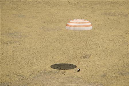The Soyuz TMA-03M capsule, carrying International Space Station (ISS) crew members Expedition 31 Commander Oleg Kononenko of Roscosmos, Flight Engineers Don Pettit of NASA and Andre Kuipers of the European Space Agency, lands in a remote area near the town of Zhezkazgan in this July 1, 2012 handout. The astronauts have completed their six-and-a-half-month mission on the ISS, according to NASA. REUTERS/NASA/Bill Ingalls/Handout