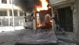 A fire burns after a shelling at Juret al-Shayah in Homs city July 1, 2012. REUTERS/Shaam News Network/Handout