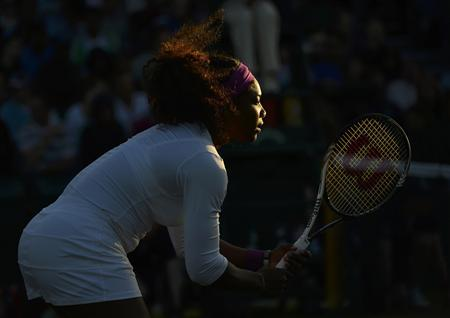 Serena Williams of the U.S. stands ready during her women's doubles tennis match with her partner Venus Williams of the U.S. against Maria Kirilenko of Russia and Nadia Petrova of Russia at the Wimbledon tennis championships in London June 30, 2012. REUTERS/Toby Melville
