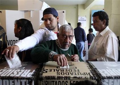 People cast their votes in Mexico City July 1, 2012. Mexicans began voting for a new president on Sunday with the opposition party that dominated the country for most of the past century poised for a comeback after the ruling conservatives failed to provide strong growth or halt a brutal drugs war. REUTERS-Ginnette Riquelme