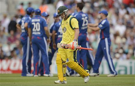 Australia's David Warner leaves the field after being dismissed during the second one-day international against England at the Oval cricket ground in London July 1, 2012. REUTERS/Philip Brown