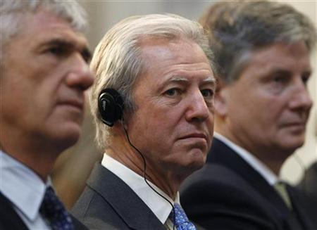 Barclays chairman Marcus Agius listens as France's Prime Minister Francois Fillon delivers his keynote address at Guildhall in London January 13, 2011. REUTERS/Suzanne Plunkett