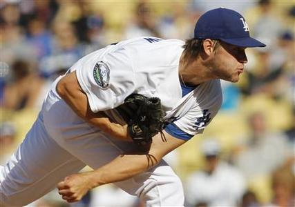 Los Angeles Dodgers starting pitcher Clayton Kershaw delivers against the New York Mets during the first inning of their MLB baseball game in Los Angeles July 1, 2012. REUTERS/Danny Moloshok