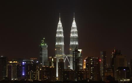 The Petronas Twin Towers in Kuala Lumpur are pictured before lights were turned off for Earth Hour, in this March 26, 2011 file photograph. REUTERS/Bazuki Muhammad/Files