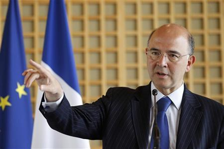 French Finance Minister Pierre Moscovici leaves a news conference at the Bercy Ministry building in Paris June 13, 2012. REUTERS/Gonzalo Fuentes