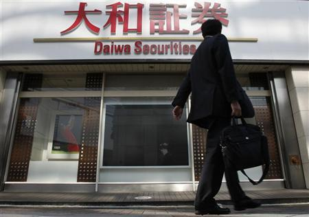 A businessman walks past a branch of Daiwa Securities in Yokohama, south of Tokyo, April 26, 2011. REUTERS/Yuriko Nakao