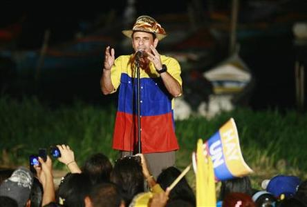 Opposition candidate Henrique Capriles speaks to supporters during a rally at Guajira, in the western state of Zulia July 1, 2012. President Hugo Chavez shook off his health problems to lead a massive rally on Sunday while opposition rival Capriles took to remote regions for the formal launch of Venezuela's presidential race. REUTERS/Isaac Urrutia