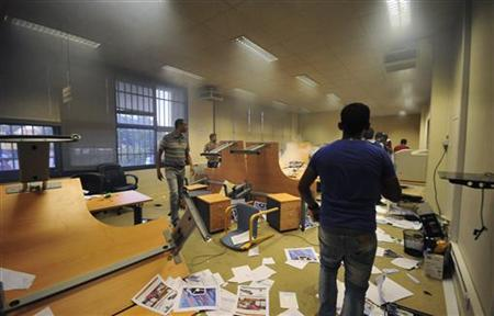 Protesters storm the office of the national election commission in Benghazi July 1, 2012. REUTERS/Esam Al-Fetori