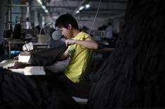 An employee works at the Yiwu Lianfa clothing factory in Yiwu, Zhejiang province, June 8, 2011. REUTERS/Carlos Barria