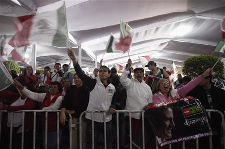 Supporters of Enrique Pena Nieto, presidential candidate of the Institutional Revolutionary Party (PRI), celebrate at the party headquarters in Mexico City, July 1, 2012. REUTERS/Edgard Garrido