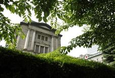The Bank of Japan headquarters building is framed by leaves in Tokyo June 15, 2012. REUTERS/Yuriko Nakao