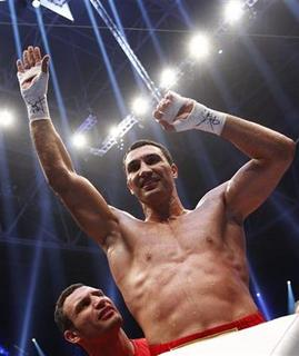 Heavyweight boxing title holder Vladimir Klitschko of Ukraine celebrates with his brother Vitali (L) after defeating Jean-Marc Mormeck of France in their IBF/WBO, WBA and IBO world heavyweight championship title fight in Duesseldorf March 3, 2012. REUTERS/Kai Pfaffenbach