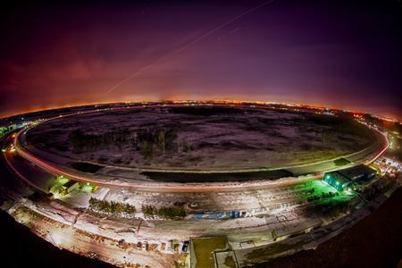 A night view of Fermilab's Tevatron accelerator outside Chicago, Illinois is seen in a February 8, 2011 handout photo.REUTERS/Fermilab/Reidar Hahn/Handout