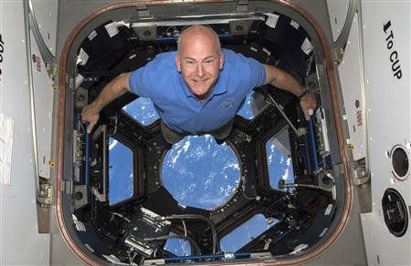 STS-131 commander Alan Poindexter poses for a photo in the Cupola of the International Space Station in this NASA file photograph on April 17, 2010. Former astronaut Alan Poindexter died in a water sports accident in Florida on July 1, 2012, NASA confirmed. REUTERS/NASA/Files