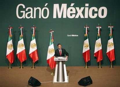 Enrique Pena Nieto, presidential candidate of the Institutional Revolutionary Party (PRI), gives a speech next to a sign that reads ''Mexico win'', after exit polls showed him in first place, in Mexico City July 1, 2012. The party that ruled Mexico for most of the 20th century claimed victory in a presidential election on Sunday as a senior election official said the party's candidate, Enrique Pena Nieto, held an irreversible lead over his rivals.REUTERS/Tomas Bravo