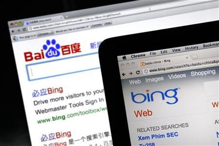 A photo illustration shows the websites of search engines Baidu and Bing on computer screens in Shanghai July 5, 2011. REUTERS/Carlos Barria