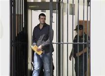 Dutch citizen Joran Van der Sloot walks handcuffed to a courtroom at the Piedras Gordas prison in Lima May 8, 2012. REUTERS/Jose Huaynate