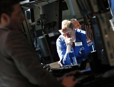 Traders work on the floor of the New York Stock Exchange, July 2, 2012. REUTERS/Brendan McDermid