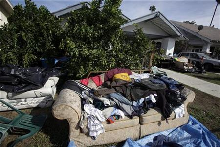 A pile of clothes and a sofa sit outside a foreclosed home in Los Angeles, California, October 25, 2010. REUTERS/Lucy Nicholson
