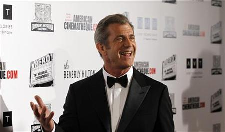 Actor Mel Gibson poses at the ceremony for the 25th American Cinematheque Award in Beverly Hills, California October 14, 2011. REUTERS/Mario Anzuoni/Files