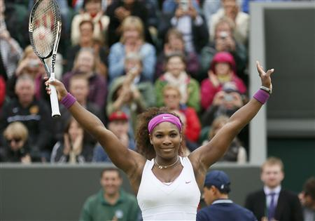 Serena Williams of the U.S. celebrates after defeating Yaroslava Shvedova of Kazakhstan during their women's singles tennis match at the Wimbledon tennis championships in London July 2, 2012. REUTERS/Stefan Wermuth