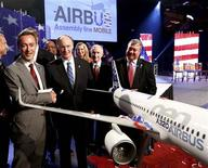 Airbus CEO Fabrice Bregier (L) shakes hands with Alabama Governor Robert Bentley during a news conference in Mobile, Alabama July 2, 2012. European planemaker Airbus held a news conference to announce that they will construct an assembly plant for their A320 in Mobile. The plant will give Airbus its first assembly site in the United States. REUTERS/Jonathan Bachman
