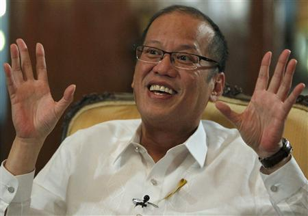 Philippine President Benigno Aquino gestures during an interview with Reuters at the Malacanang presidential palace in Manila in this July 2, 2012 file photograph. REUTERS/Erik De Castro/Files