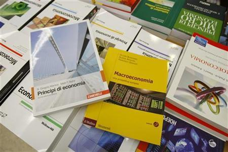 Italian language economics textbooks are seen on display in this picture illustration at a book store in Milan June 28, 2012. A revolution is building at the heart of academic economics, particularly in Europe. As the crisis deepens, economists have been forced to turn away from classroom theories and look at the real world - from insects to financial markets, from banks to brain scans. REUTERS/Alessandro Garofalo