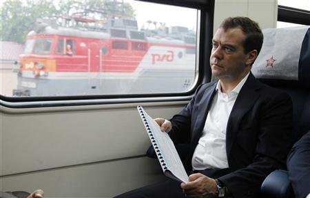 Russian Prime Minister Dmitry Medvedev rides on the airport rail link to Vladivostok airport July 3, 2012. REUTERS/Dmitry Astakhov/RIA Novosti/Pool