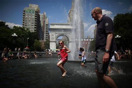 People play in the fountain at Washington Square Park in New York July 1, 2012. REUTERS/Eric Thayer
