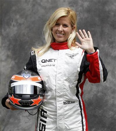 Marussia Formula One test driver Maria de Villota of Spain poses prior to the Australian F1 Grand Prix at the Albert Park circuit in Melbourne March 15, 2012. REUTERS/Daniel Munoz