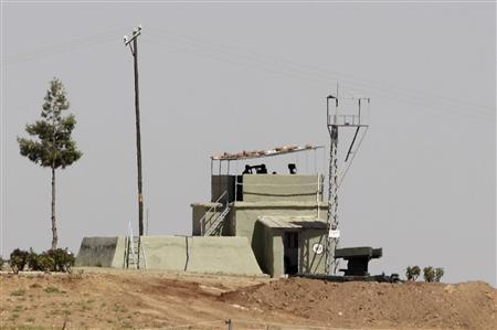 A mobile missile launcher is positioned at a military base on the Turkish-Syrian border in Oncupinar in Kilis province, southern Turkey July 3, 2012. REUTERS/Osman Orsal