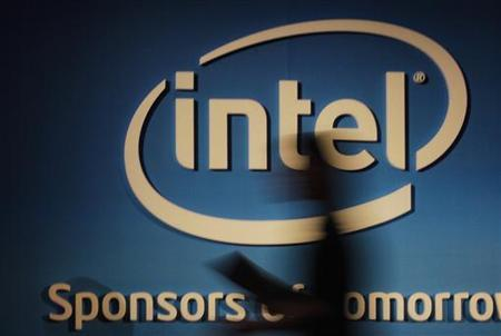 A woman walks past an Intel logo at the 2012 Computex in Taipei June 5, 2012. Computex, the world's second largest consumer electronics trade fair, runs from June 5 to 9. REUTERS/Yi-ting Chung