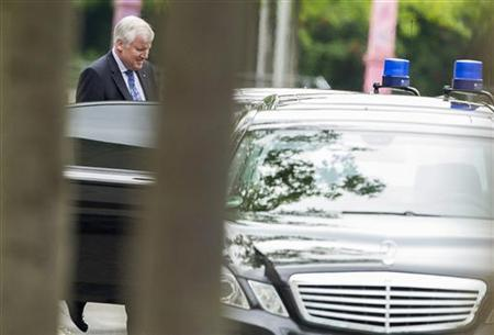 The leader of the Christian Social Union (CSU) party Horst Seehofer leaves the Chancellery after talks with the heads of the government coalition parties in Berlin, June 4, 2012. REUTERS/Thomas Peter